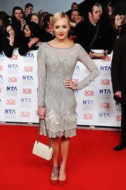 Fearne Cotton teamed her Art Deco-inspired dress with a timeless ivory quilted purse at the National Television Awards.