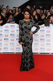 Jessica Wright smoldered in a long-sleeve lace gown at the National Television Awards.