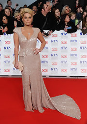 Sam Faiers wore a glitzy champagne evening dress with a long train on the National Television Awards' red carpet.