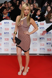 Laura Whitmore paired her printed dress with nude platform peep-toe pumps complete with bow detailing.