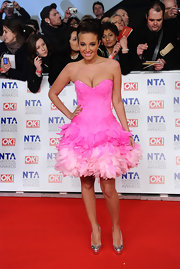 Tulisa paired her eclectic pink dress with metallic silver platform pumps.