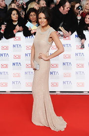 Michelle Keegan wore a beaded ivory gown with a train to the National Television Awards.