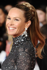 Elle MacPherson wore her hair in a sleek ponytail with a pretty braided accent at the National Television Awards.