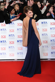 Paula Lane wore this dramatic draped backless gown to the National Television Awards.