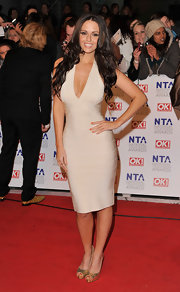 Jennifer dons a nude bandage dress with a deep plunging neckline at the National Television Awards.