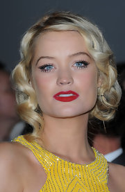 Laura Whitmore looked very dramatic at the National Television Awards with her bright red lips and retro updo.