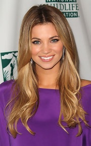 Amber Lancaster let her hair cascade down her shoulders at the Voices for Wildfire event. A simple center part help complete her look.
