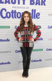 Laura Marano rounded out her look with black peep-toe ankle boots.