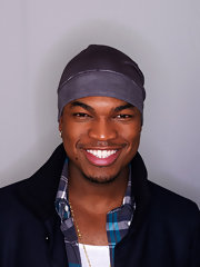Ne-Yo sports a slick gray knit beanie.