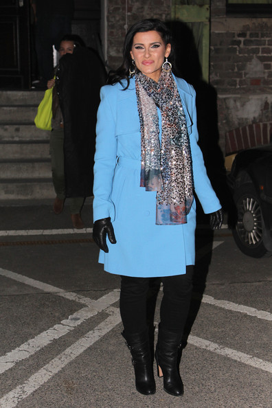 Nelly Furtado's baby blue coat was a bright and cheerful look for the singer.