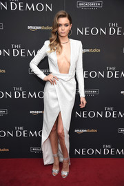 Abbey Lee teamed her bold dress with elegant silver ankle-wrap sandals by Loeffler Randall.