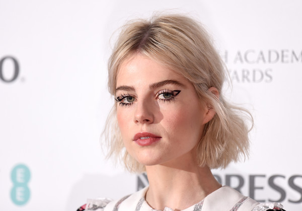 More Pics of Lucy Boynton Print Dress (7 of 12) - Dresses & Skirts Lookbook - StyleBistro [hair,face,eyebrow,blond,lip,hairstyle,skin,chin,nose,cheek,nespresso,red carpet arrivals,lucy boynton,british academy film awards,england,london,kensington palace,nominees party,nominees party]