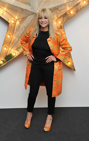 Jo added some zest to her party look with this orange and gold rose embroidered coat.
