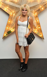 Pixie Lott attended Net-a-Porter's Dolce & Gabbana party in London wearing (naturally) a Dolce & Gabbana white frock from their popular Spring '11 collection. The starlet completed her ensemble with black ankle boots, a glowing tan and her signature bleached 'do.