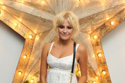 Pixie Lott attends a party for Dolce And Gabbana hosted by Net-a-Porter at Westfield on July 14, 2011 in London, England.
