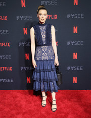 A black leather purse with a beaded handle finished off Gillian Jacobs' outfit.