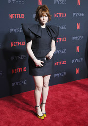 A pair of yellow satin pumps with black trim completed Natasha Lyonne's look.