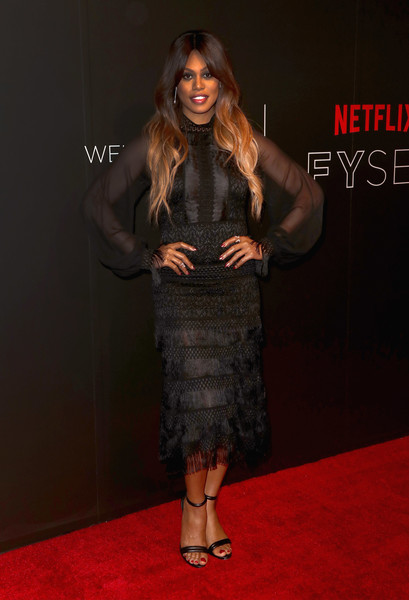 Laverne Cox polished off her red carpet look with black ankle-strap sandals by Kenneth Cole.