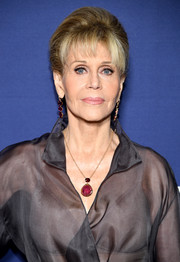 Jane Fonda accessorized with a lovely gemstone pendant by Irene Neuwirth.