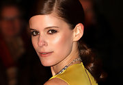 Kate Mara illuminated her dark brown eyes with a sweep of bronze metallic shadow.