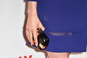 Taylor Schilling attended the Netflix launch party in Paris carrying a chic black and gold clutch by Corto Moltedo.