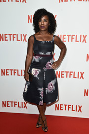 Uzo Aduba paired her beautiful dress with classic T-strap sandals.
