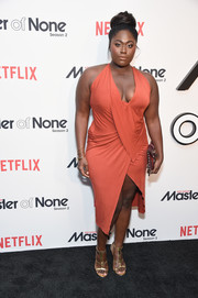 Danielle Brooks looked va-va-voom in a coral halter dress with a plunging neckline and an asymmetrical hem at the premiere of 'Master of None' season 2.