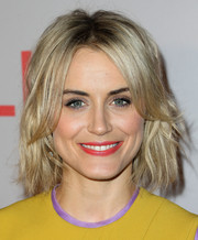 Taylor Schilling's red lipstick worked beautifully with her yellow and lavender outfit.