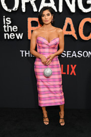 For a dose of sparkle, Diane Guerrero accessorized with a silver orb purse.