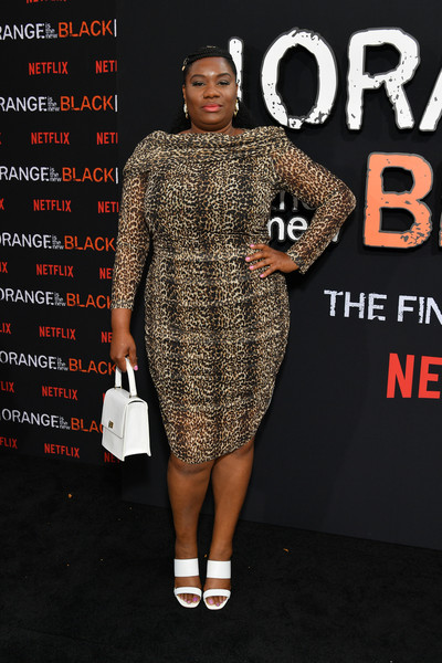 Adrienne C. Moore styled her frock with strappy white heels by Aldo.