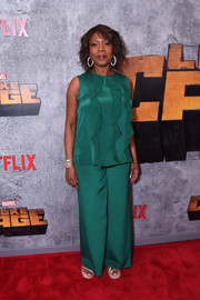 Alfre Woodard donned an emerald-green ruffle blouse for the premiere of 'Luke Cage' season 2.