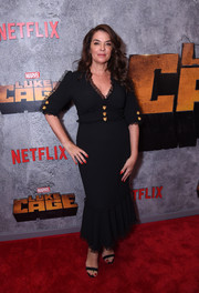 Annabella Sciorra chose a black mermaid gown with lace trim and gold buttons for the premiere of 'Luke Cage' season 2.