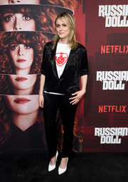 Taylor Schilling teamed white pumps with a beaded black pantsuit and a graphic shirt for the premiere of 'Russian Doll' season 1.