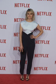 Taylor Schilling styled her jumpsuit with black gladiator sandals.
