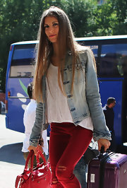 Cathy sported a rocker chic look with a washed-out denim jacket and ripped pants.