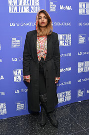 M.I.A. attended the New Directors/New Films 2018 opening wearing a black wool coat over a printed hoodie.