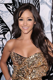 Melanie Iglesias styled her brunette curls in long side swept curls for the 'Maxim' Hot 100 party.