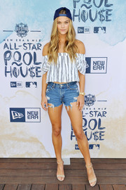 Nina Agdal added major sexiness with a pair of torn jean shorts.