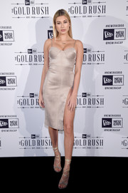 Hailey Baldwin sizzled in a nude House of CB corset dress with a way-up-to-there slit while partying at the New Era Style Lounge.