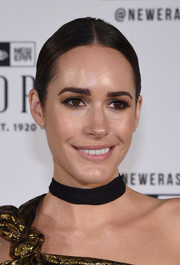Louise Roe partied at the New Era Style Lounge wearing this tight center-parted ponytail.