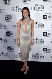 Jamie Chung turned heads at the New Era Style Lounge in a silver Misha Collection dress with a slashed bodice.