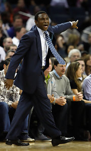 Avery Johnson motioned frantically in a handsome blue checkered tie during his game versus the Charlotte Bobcats.
