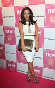 Chelsee Healey chose this gold oversized clutch to top off her red carpet look.