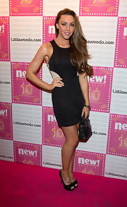 Michelle Heaton carried a small quilted purse at the birthday bash of New! Magazine.