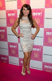 Lizzie Cundy opted for a feminine lace cocktail dress for her red carpet look.