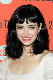 Krysten Ritter paired her ultra dark locks with a coral pout at the opening night of 'All New People.'
