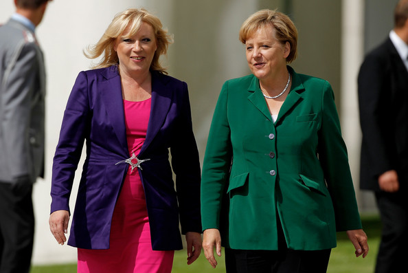 Here, Angela Merkel added some color with a bright green blazer.