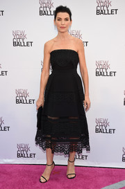 Julianna Margulies complemented her lovely dress with simple black ankle-strap sandals.