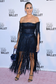 Sarah Jessica Parker sealed off her sophisticated look with a blue satin purse by Gabriela Hearst.