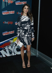 The actress topped off her ensemble with a tasseled white faux-leather clutch by Nikki Reed x Freedom of Animals.